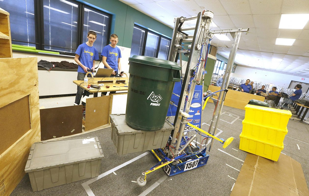 Members of the 2015 Lockport High School robotics team examine a project. The current team was among recipients of grants from General Motors Oct. 4, 2017. (News file photo)