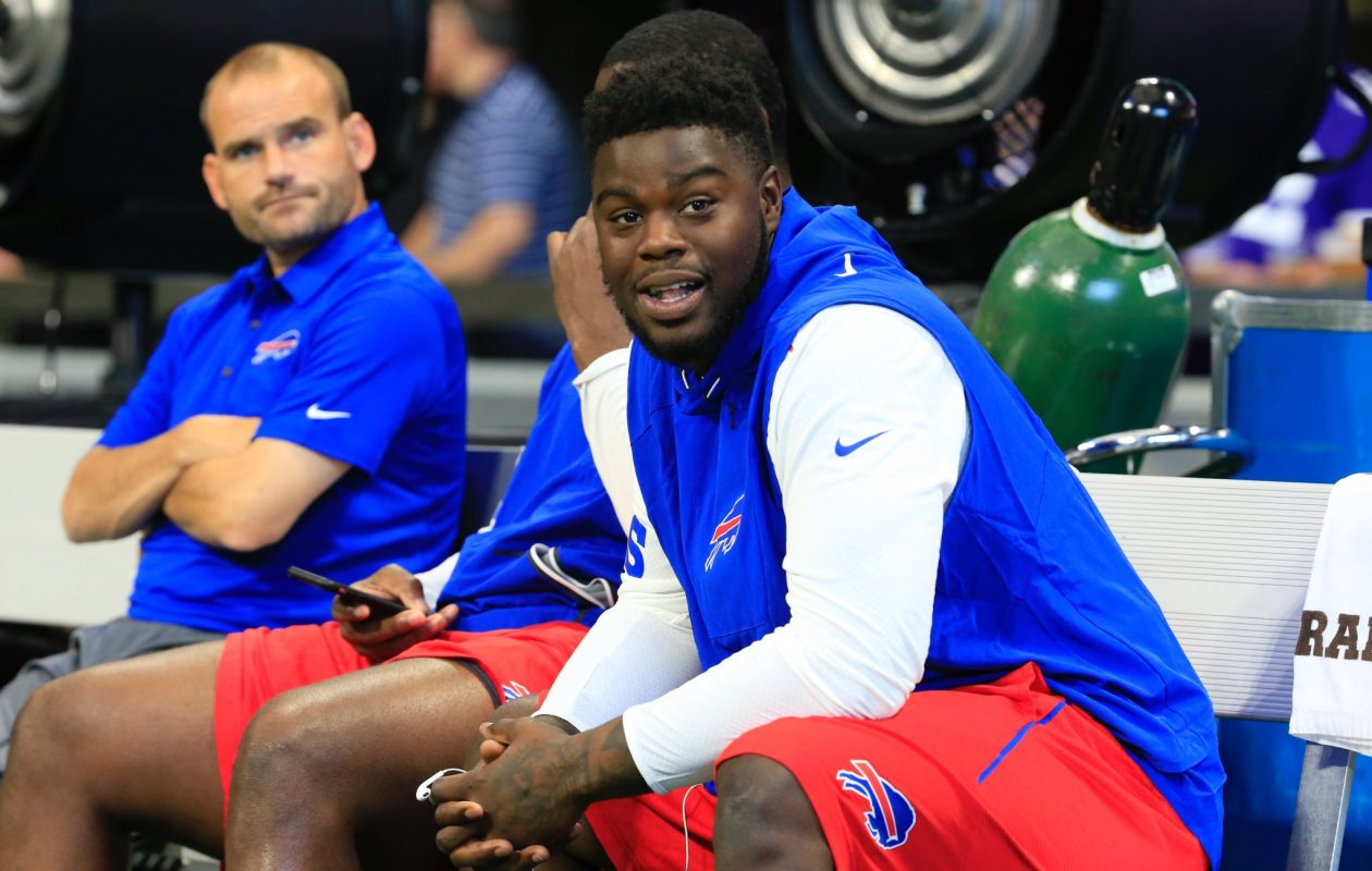 Shaq Lawson sits on the bench while his teammates warm up. Lawson suffered a groin injury during practice Thursday and will be inactive for today's game against the Falcons.  (Harry Scull Jr./Buffalo News)