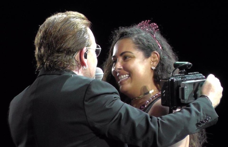 Silvia Rigote, on stage with Bono during last month's U2 concert in Buffalo. (Photo courtesy Brad Parmeter)
