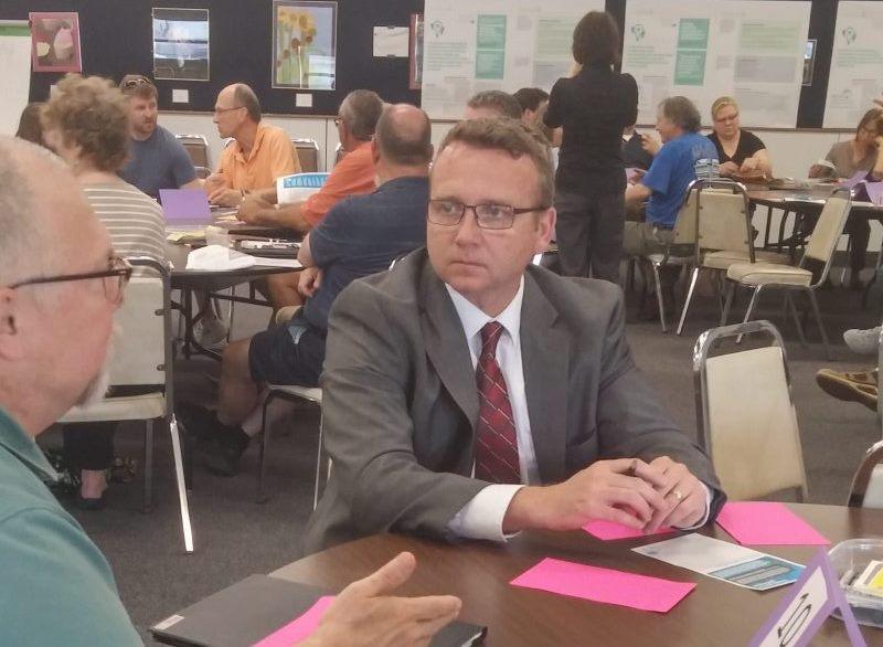Gary Schulenberg of Kenmore discusses the Tonawanda Tomorrow draft plan with Planning and Development Director James Hartz.
