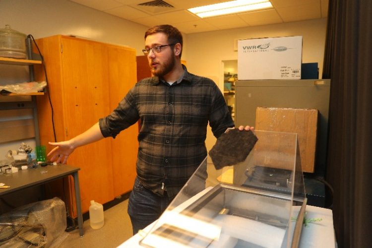 Matt Singer of Sunny Clean Water talks about the University at Buffalo startup in a lab at Davis Hall on UB's North Campus in Amherst, (John Hickey/Buffalo News)