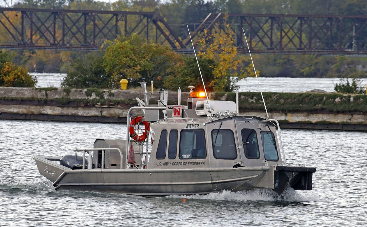An Army Corps of Engineers boat travels out of the canal near the breakwater where the swift currents of the Niagara River meet up with the slow moving canal stream near Rich Marina off Niagara Street in Buffalo on Oct. 16.  (Robert Kirkham/Buffalo News)