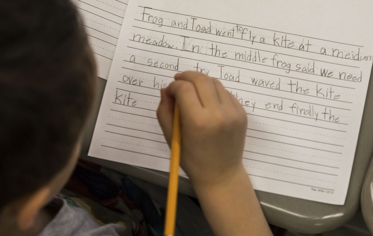 A student works on a writing assignment a first-grade class at Clinton Street Elementary School in West Seneca, where teachers and support staffs now have new contracts.  (Derek Gee/News file photo)