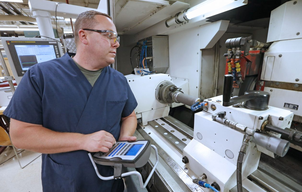 patrick barrett of north buffalo a machinist works on a part for an