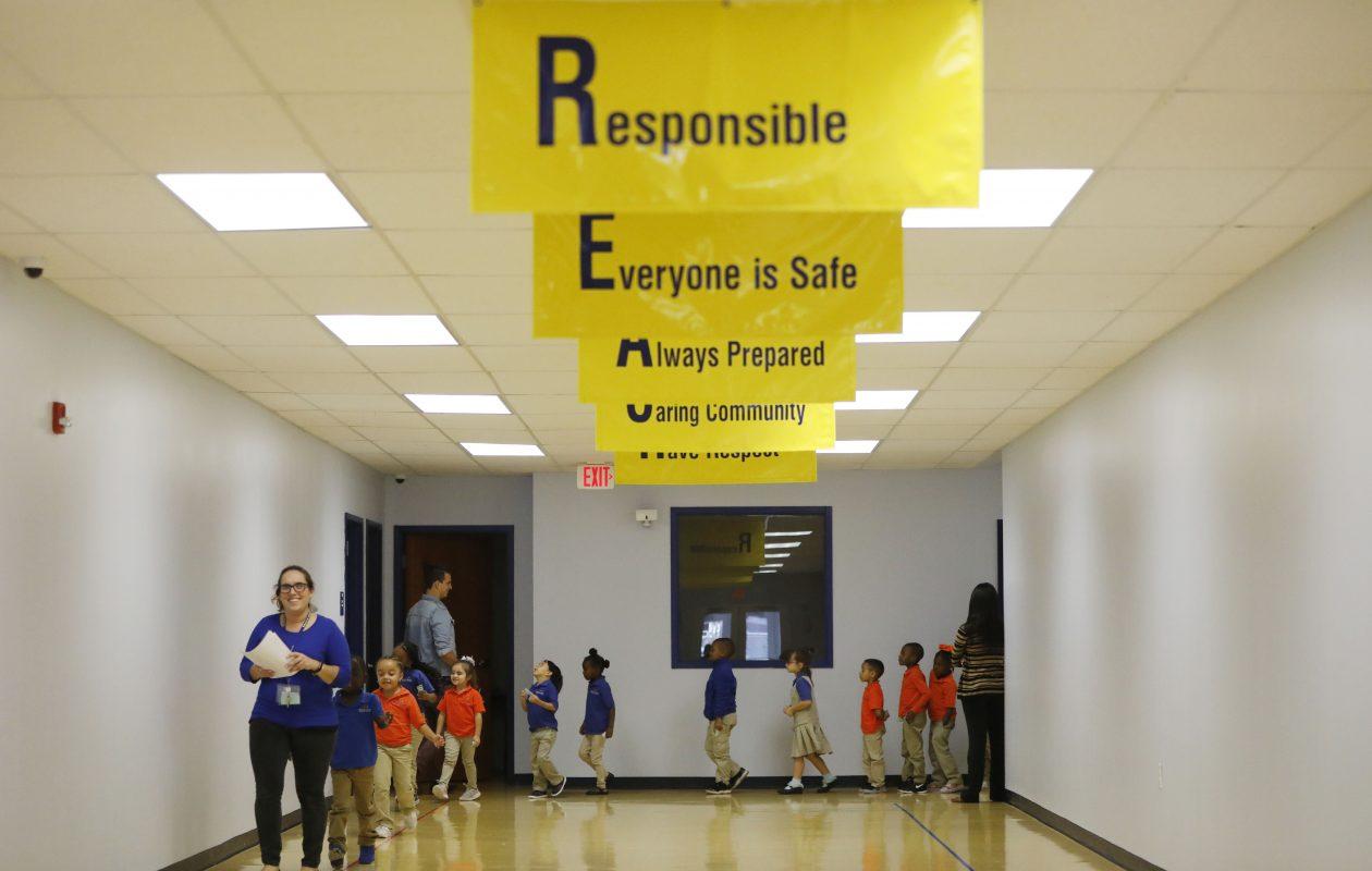 Teacher Anna Chiavaroli leads her kindergarten class down the hallway at REACH Academy Charter School which opened in September.  (Derek Gee/Buffalo News)