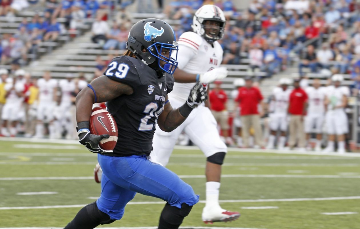 UB RB Emmanuel Reed (29) sees some wide open field as he makes a major gain in the second quarter against Northern Illinois. (Robert Kirkham/Buffalo News)