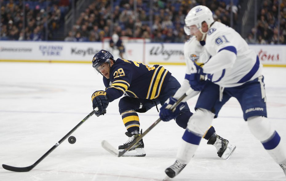 Jason Pominville tries to block the pass of Lightning's Steven Stamkos in the first period. (Mark Mulville/Buffalo News)