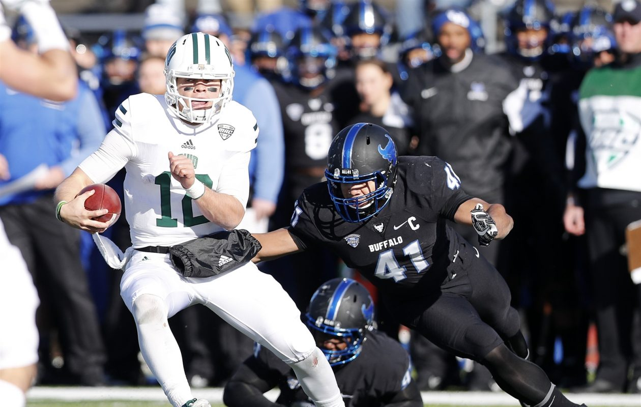 UB (41) Jarrett Franklin chases down Ohio (12) Nathan Rourke in the first half. Franklin wears No. 41 in honor of Solomon Jackson, a player who passed away in 2016 (Mark Mulville/Buffalo News)