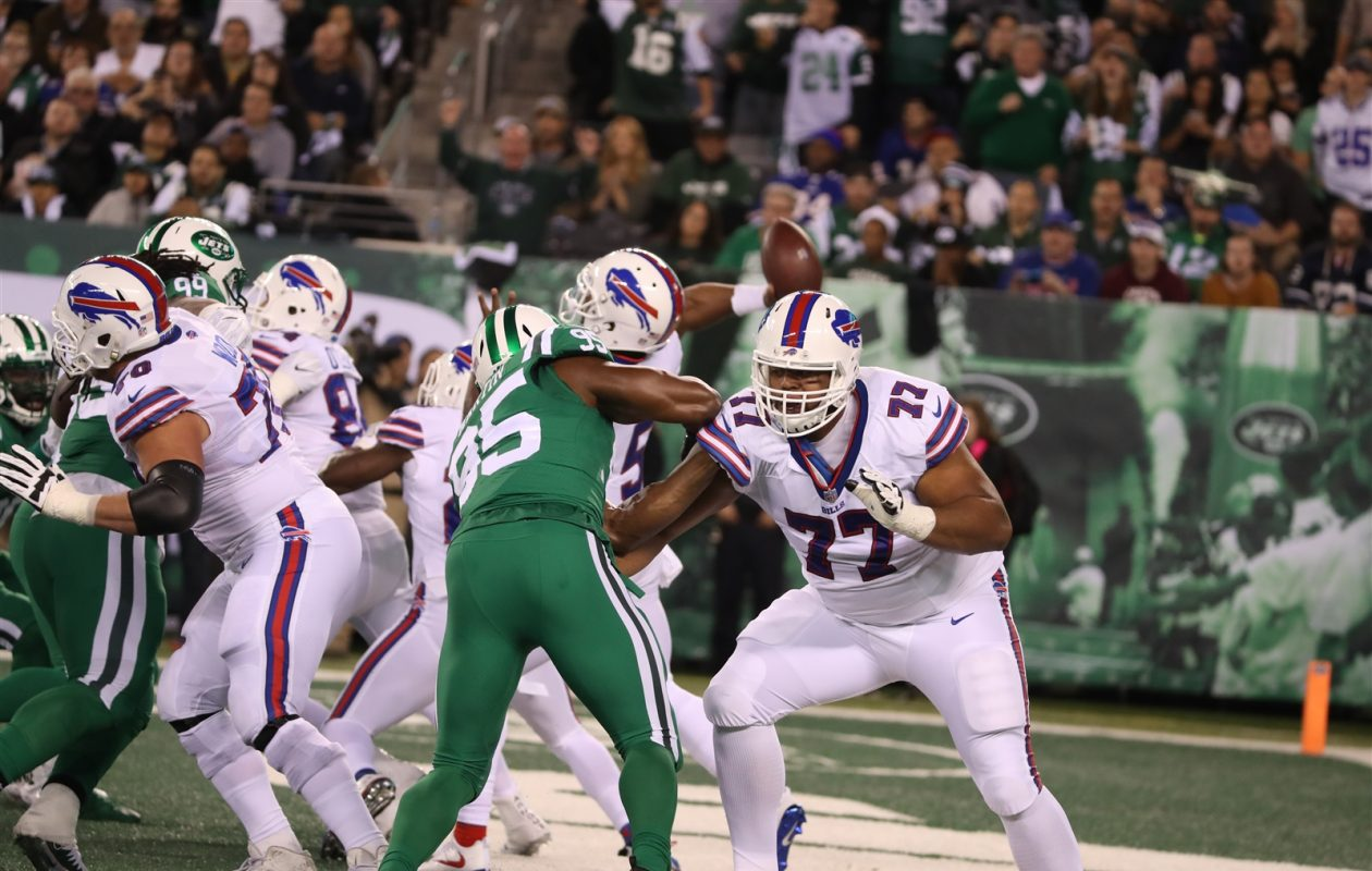 Buffalo Bills offensive tackle Cordy Glenn (77) rushes against New York Jets wide receiver Neal Sterling (85) in the first quarter. (James P. McCoy/Buffalo News)
