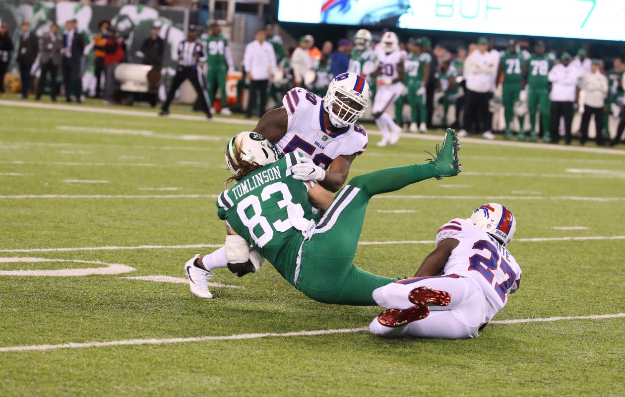 Buffalo Bills outside linebacker Ramon Humber (50) rushes for a first down against New York Jets tight end Eric Tomlinson. (James P. McCoy/Buffalo News)