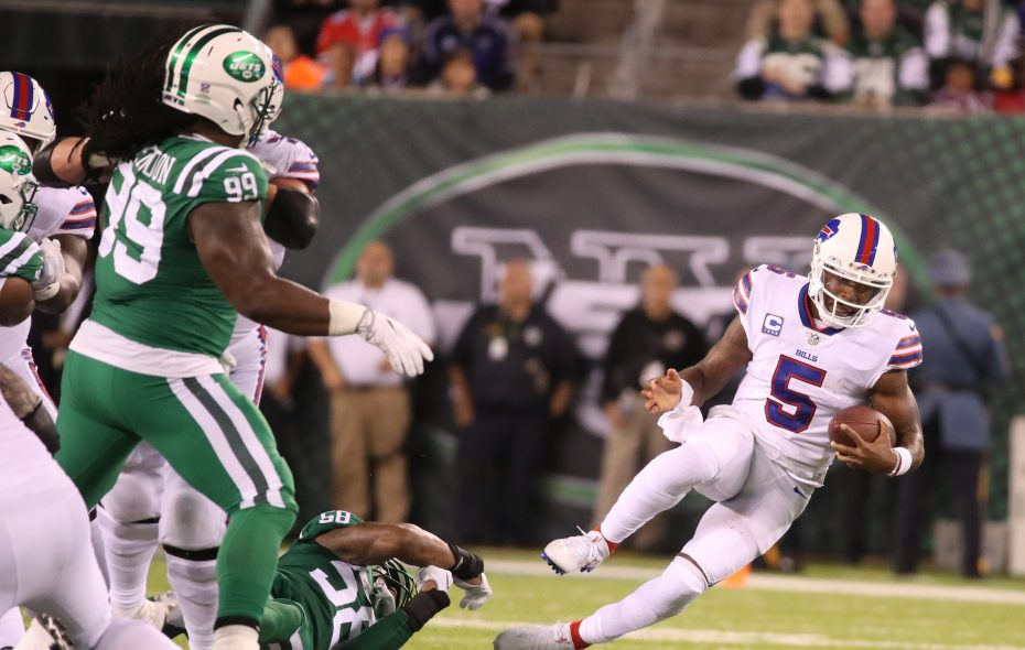 Tyrod Taylor (5) rushes away from Jets linebacker Darron Lee (58) in the second quarter  (James P. McCoy/Buffalo News)