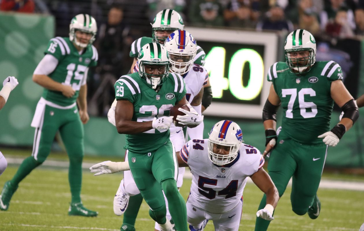 Buffalo Bills defensive end Eddie Yarbrough (54) attempts to tackle New York Jets running back Bilal Powell (29) in the third quarter at MetLife Stadium. (James P. McCoy/Buffalo News)
