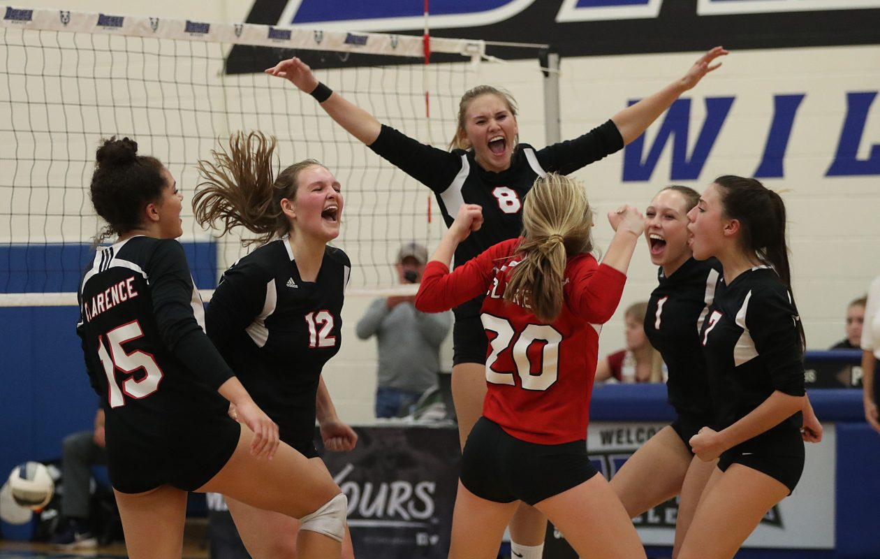 Clarence celebrates the match-winning point against Lancaster in the Section VI Class AA final at Daemen College. The Red Devils won in four sets to advance to the Far West Regionals. (Sharon Cantillon/Buffalo News)