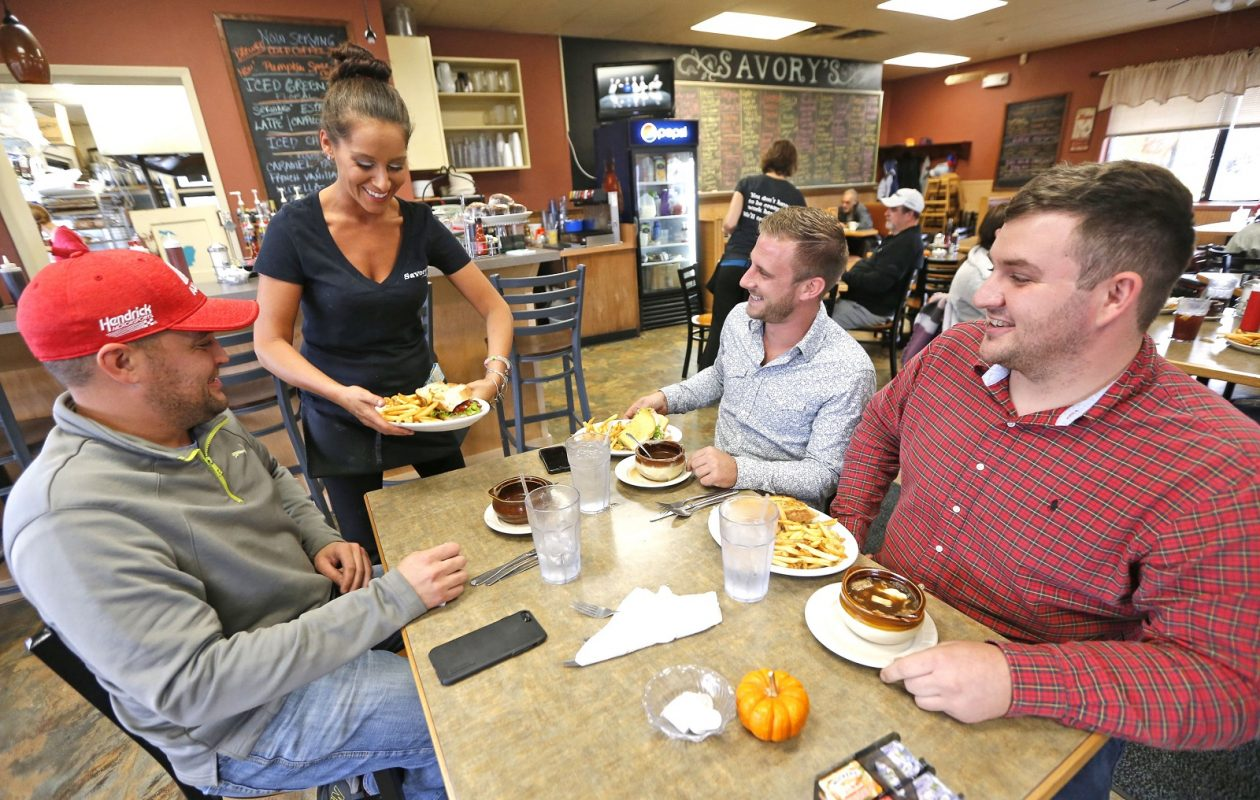 Savory's server Katie Cockerel delivers orders to lunch buddies, from left, Jay Mann, Jered Cornell and Shawn Griffin.  (Robert Kirkham/Buffalo News)