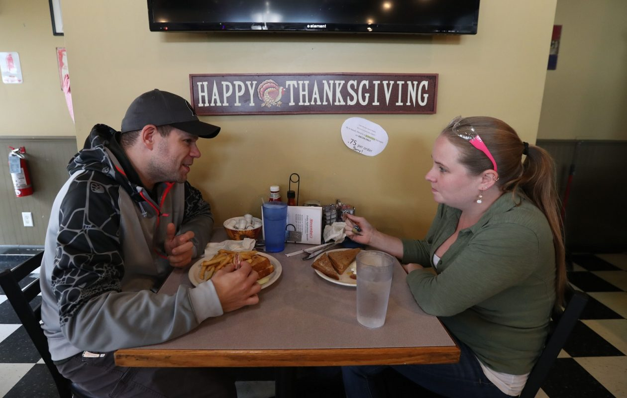 Mike Orego, left, of Amherst and Bri Behringer of Grand Island, have lunch at Emily's Diner. (Sharon Cantillon/Buffalo News)