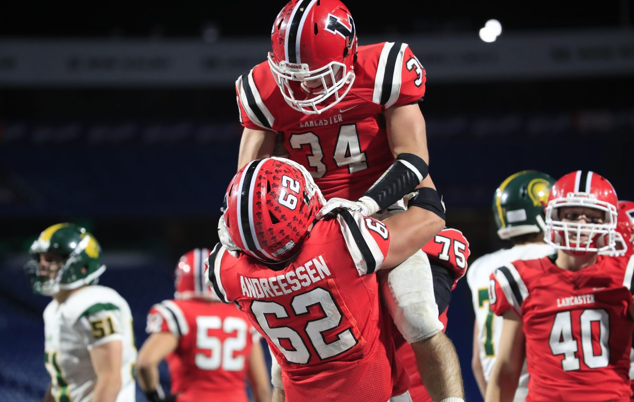 Lancaster's Joe Andreessen celebrates with running back Andrew Hersey during the Section VI Class AA final last week. (Harry Scull Jr./Buffalo News)