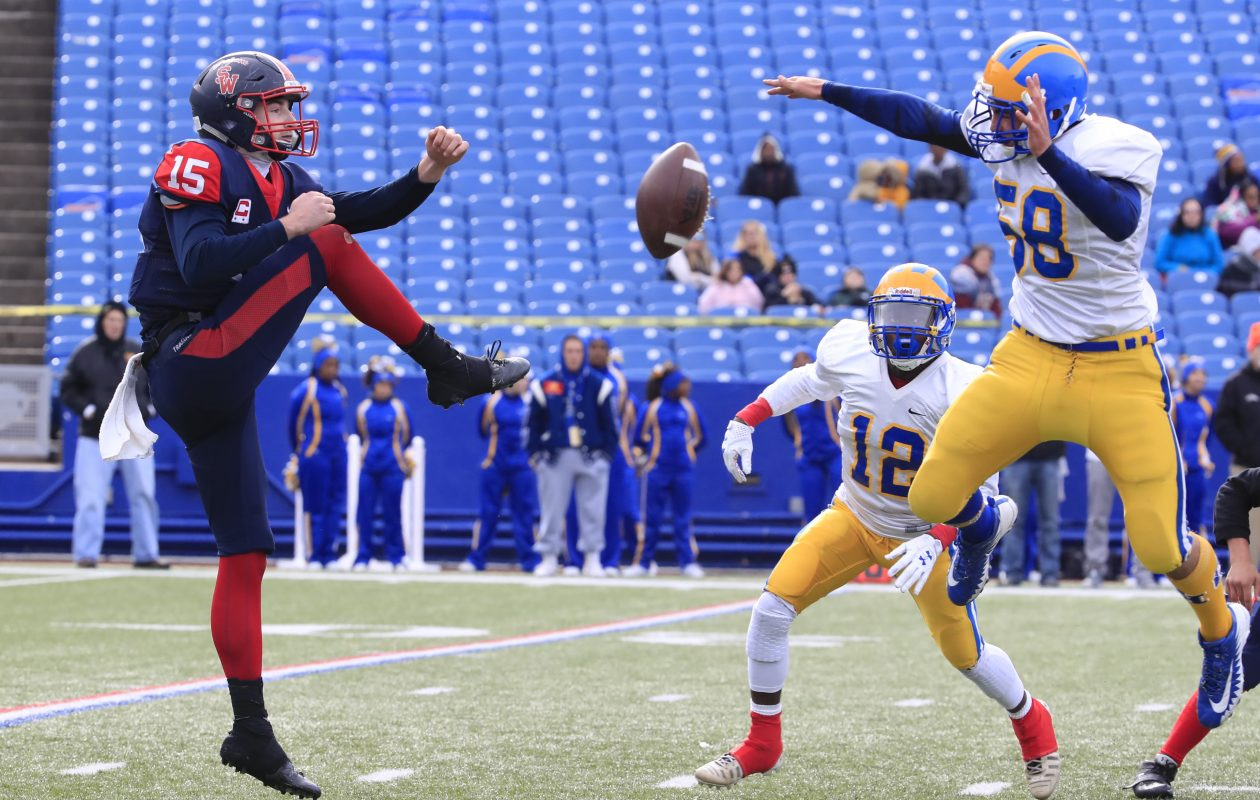 Cleveland Hill's James Purpura blocks a punt during the Section VI Class C final win over Southwestern.  (Harry Scull Jr./Buffalo News)