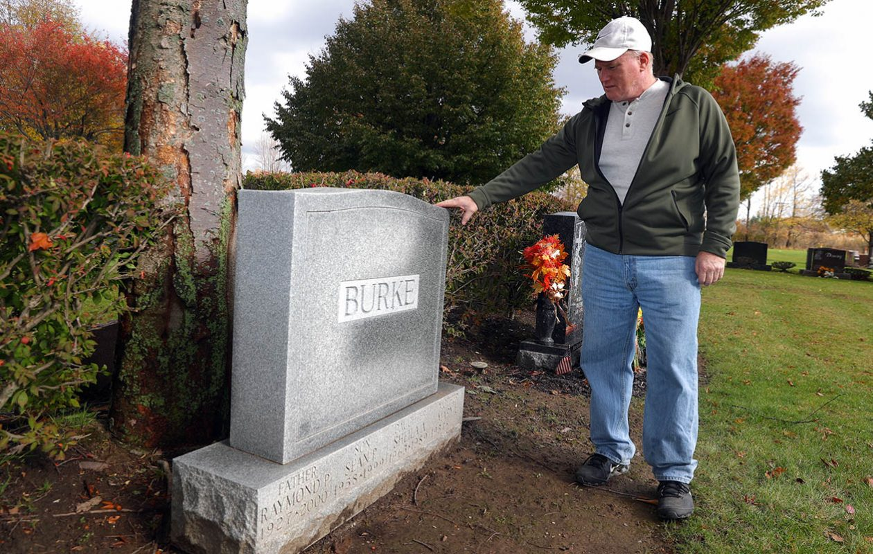 Brian Burke visits the family grave site where his sister Sheila Burke is buried in Lackawanna's Holy Cross Cemetery. Sheila Burke disappeared and was found dead in 1989. (John Hickey/Buffalo News)