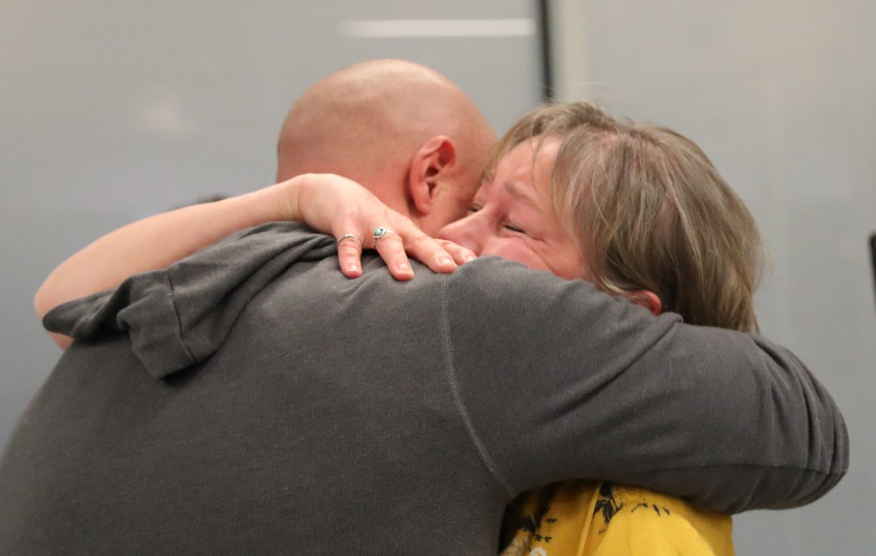 Jason Jelsovsky meets his birth mother Pam Gilham for the first time as she arrived with her husband, brother, sister and sister in law from San Antonio to the Buffalo Niagara International Airport, Thursday, Nov. 2, 2017.  Jason came with his wife Krista who found his mother. (Sharon Cantillon/Buffalo News)