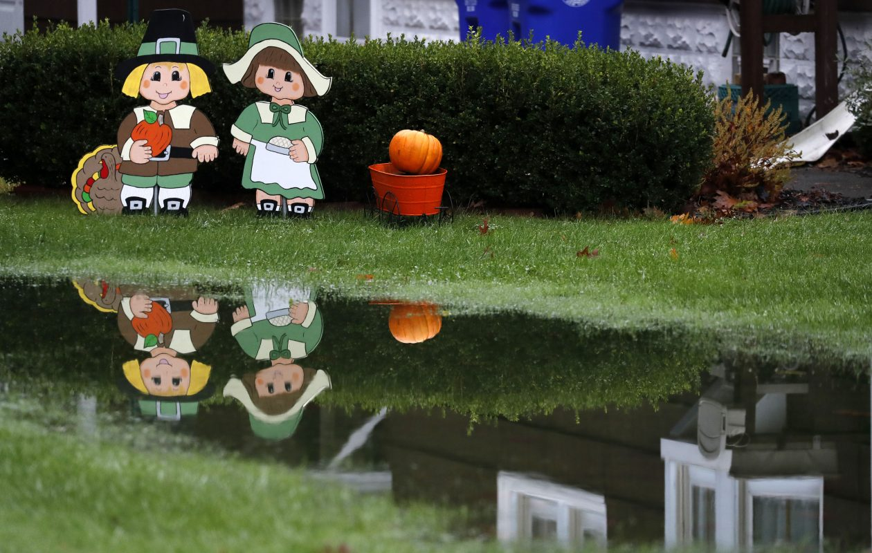 Yard decoration reflected in a puddle at a home on Clinton Street in West Seneca.  (Mark Mulville/Buffalo News)
