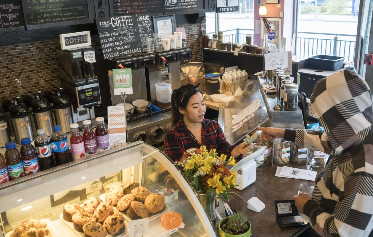 Yasuko Fukuchi waits on a customer at Perks Cafe on Elmwood and Bryant. Thursday, Nov. 9, 2017.  (Derek Gee/Buffalo News)