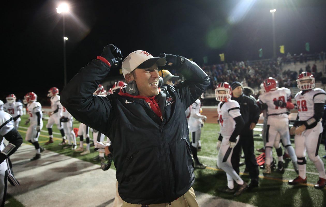 Lancaster coach Eric Rupp celebrates the 9-0 win over Aquinas on Nov. 11. (Harry Scull Jr./Buffalo News)