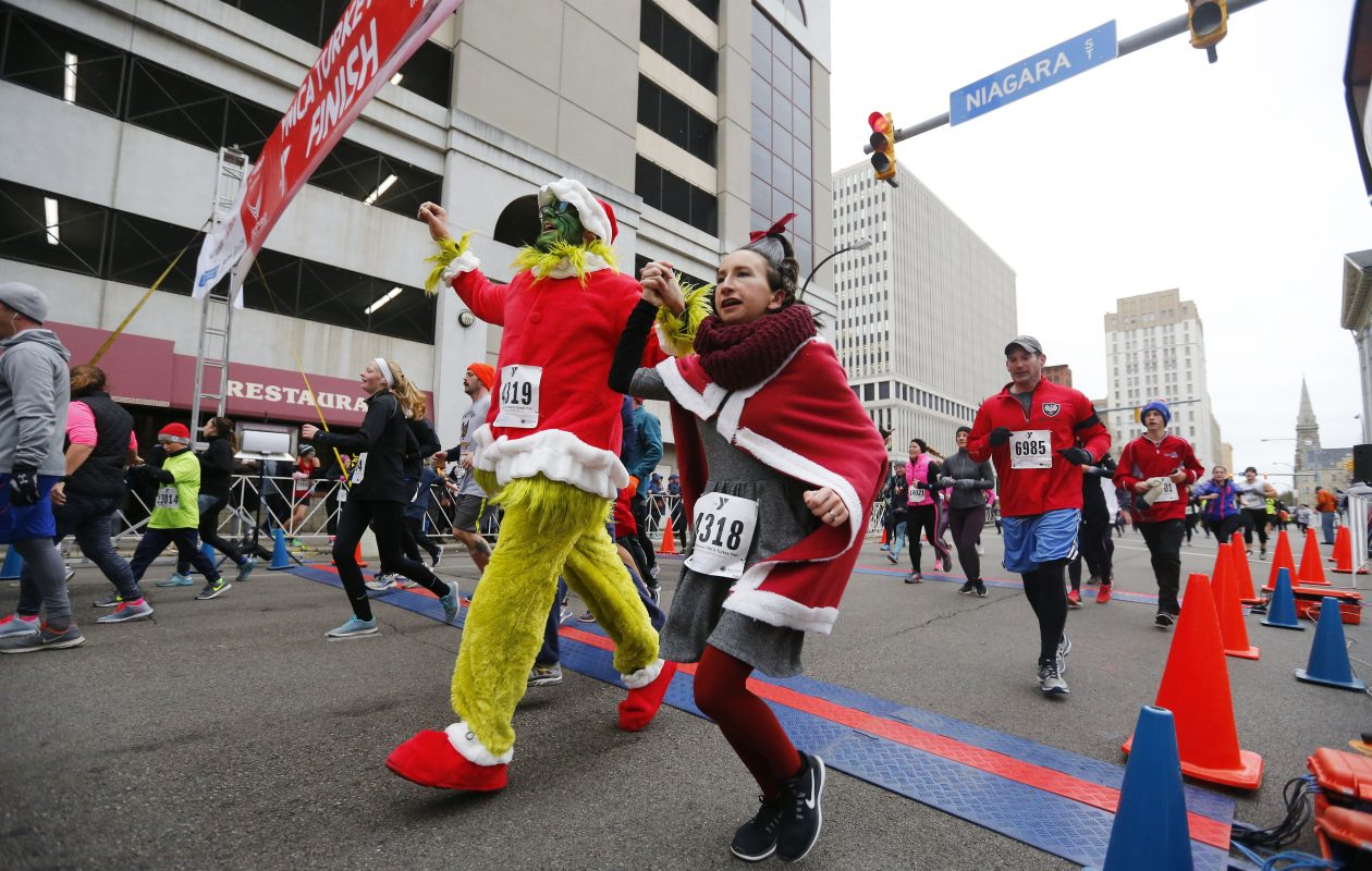 Runners cross the finish line during the 122nd annual YMCA Turkey Trot on Thursday. (Mark Mulville/Buffalo News)