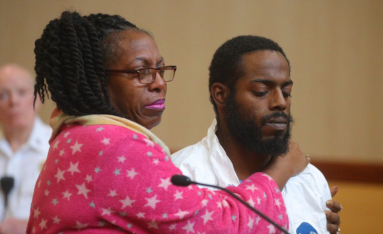 Viola Green with her son, Travis, at an earlier arraignment in Cheektowaga after his arrest. (John Hickey/Buffalo News)