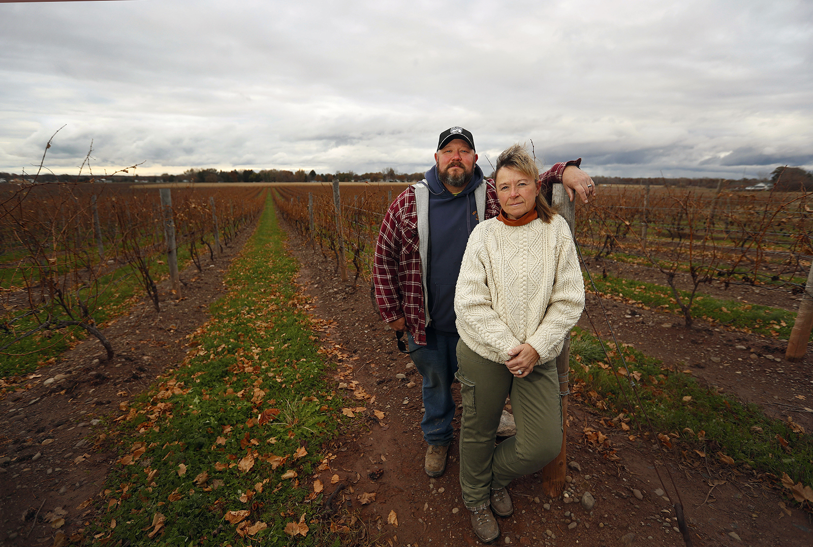 Seth and Kelly Raby stand in the vineyard on their farm in Lewiston. 'This guy never took a dime of unemployment,' Seth Raby said of Victor Pacheco. 'He paid taxes. He paid Social Security. He proved himself to us years ago.' (Mark Mulville/Buffalo News)