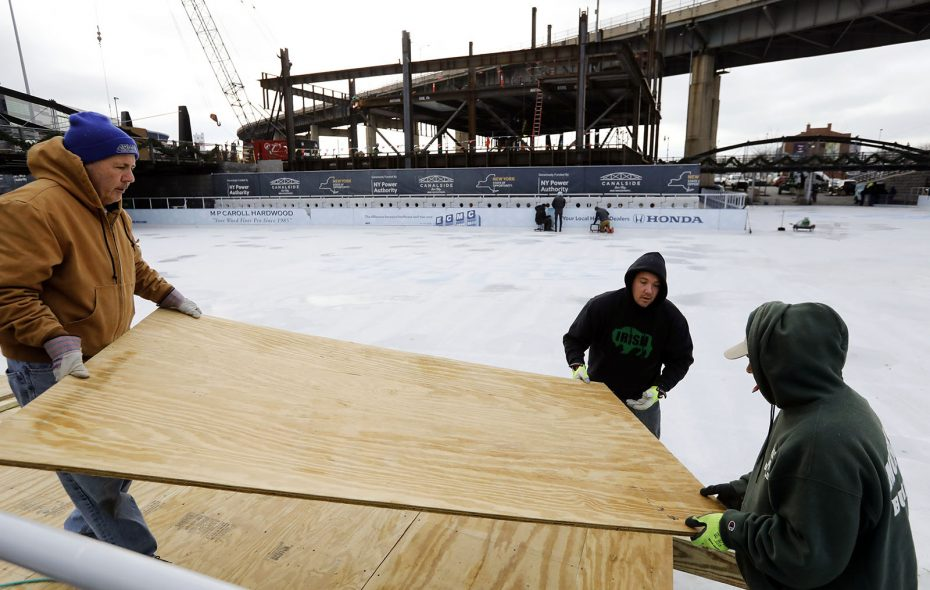 Workers from Morrison Builders build a ramp into the Ice at Canalside on Nov. 17. From left are Bill Hanley, Conor Morrison and Frank Rizzo. (Derek Gee/Buffalo News)