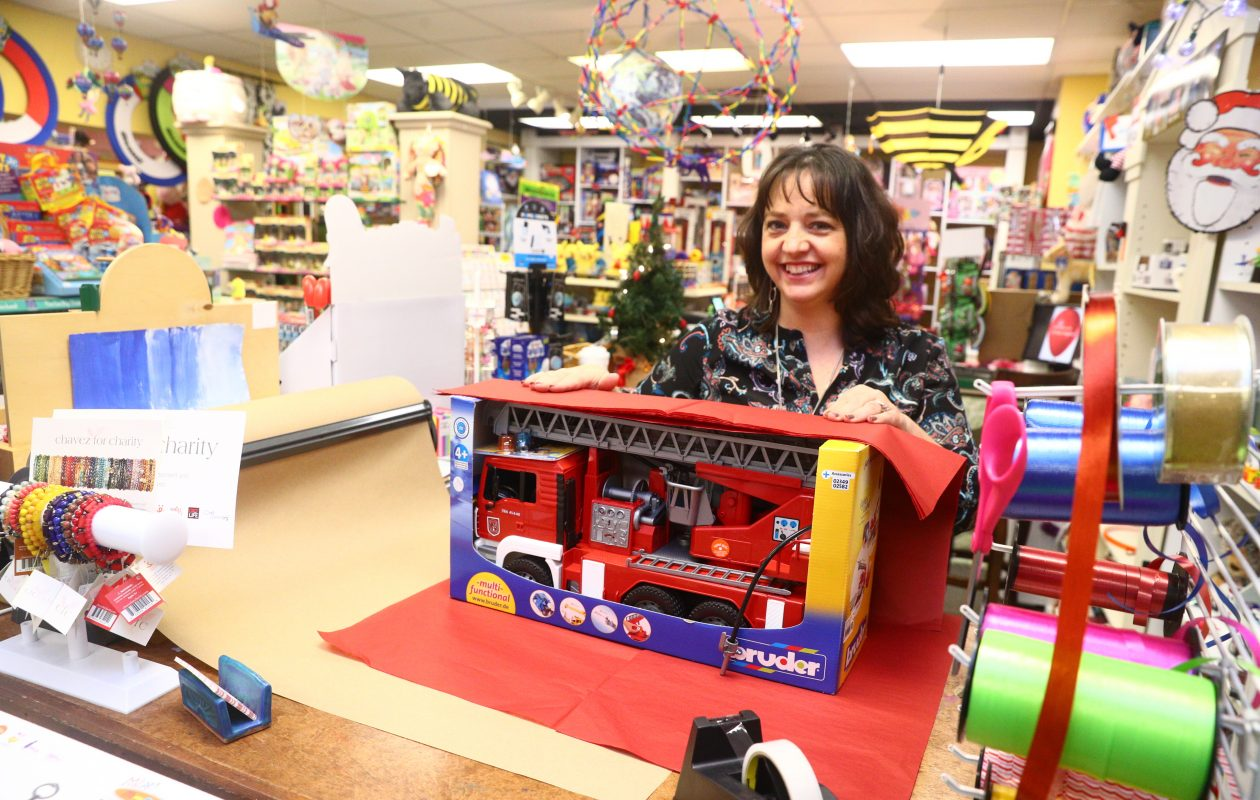 Crystal Newman owner of Bloomsbury Lane Toy Shoppe, offers gift wrapping, and will have a fire truck display to go with a big fire truck parade at 6 p.m. Saturday down Main Street past her store. (John Hickey/Buffalo News)