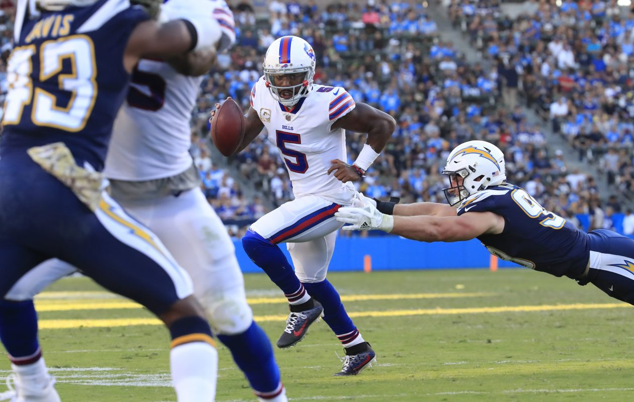 Tyrod Taylor tries to get away from the Los Angeles Chargers' Joey Bosa. (Harry Scull Jr./ Buffalo News)