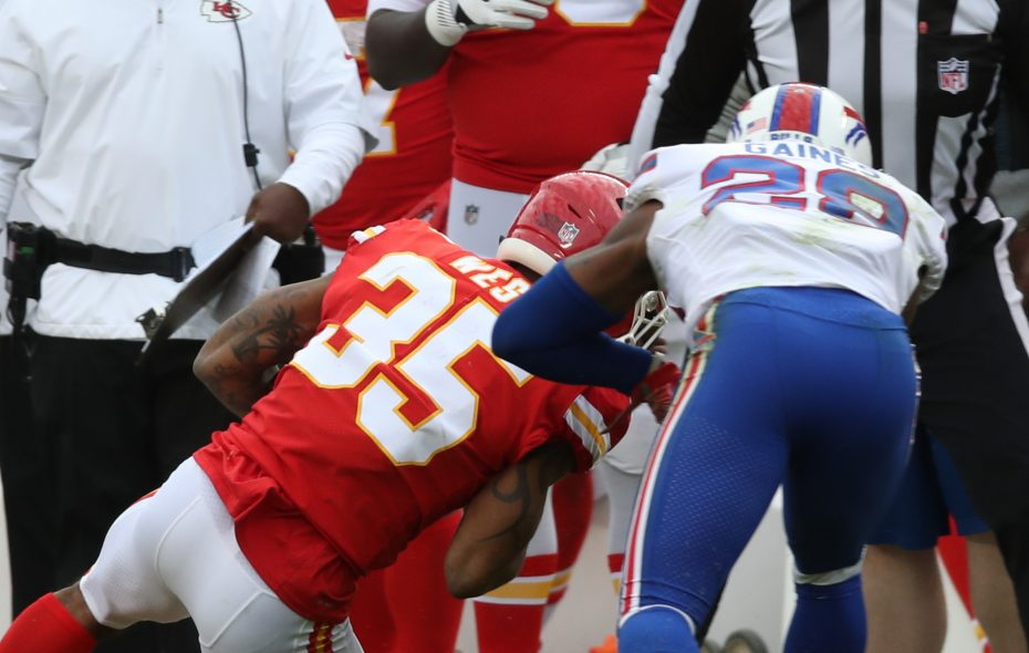 Buffalo Bills cornerback E.J. Gaines (28) was flagged for unnecessary roughness on this tackle of Chiefs running back Charcandrick West (35) in the fourth quarter.  (James P. McCoy / Buffalo News)