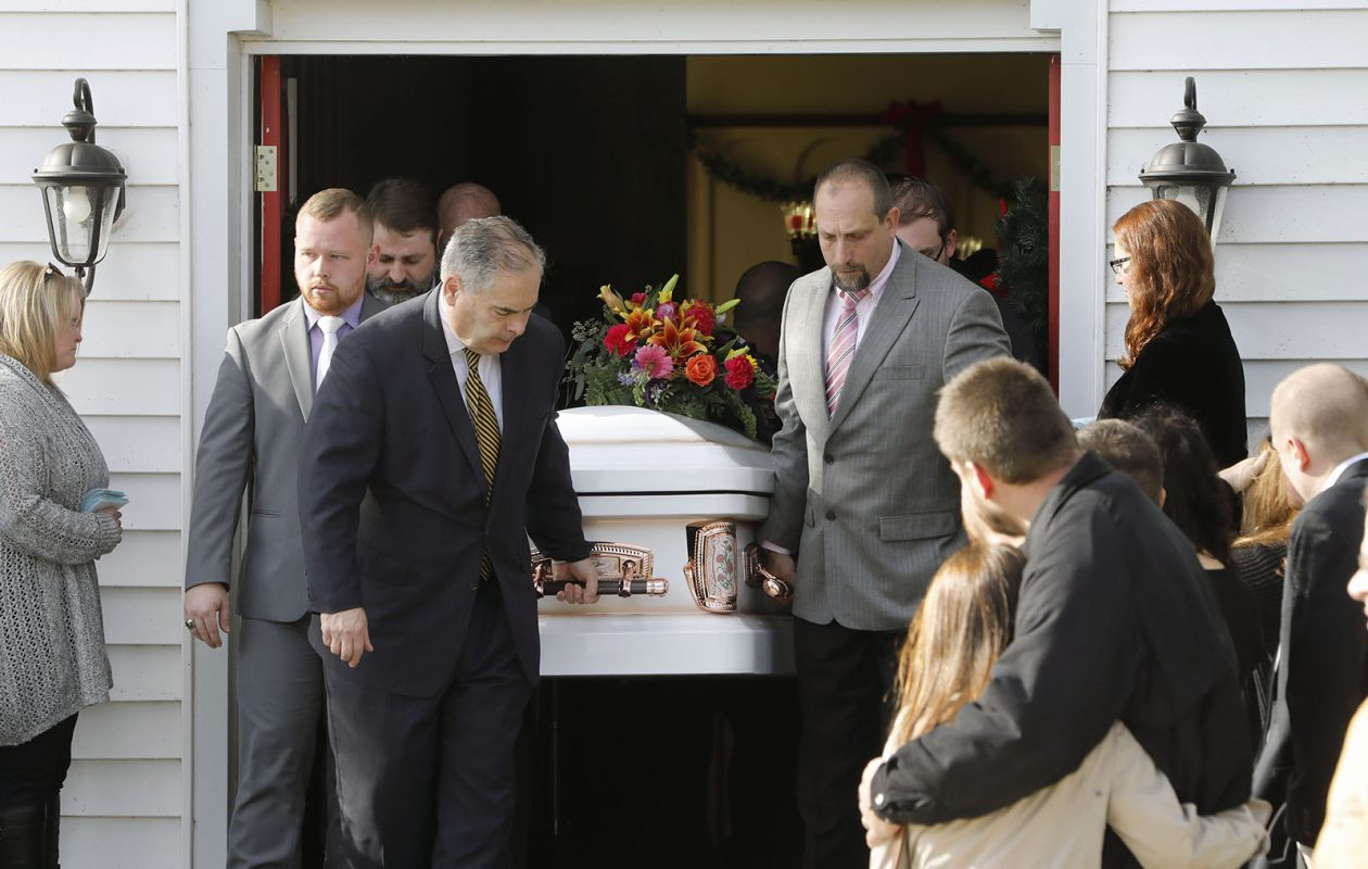 Mourners console each other as pallbearers carry the casket of Rosemary Billquist, who was shot last October by a hunter who mistook her for a deer. Thomas B. Jadlowski faces up to four years in prison for hunting after sunset. (Derek Gee/Buffalo News)