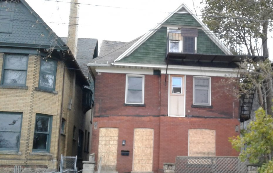 An abandoned house at 541 Fourth St., Niagara Falls, part of the area to be served by Niagara University's Rock the Block program, seen Nov. 16, 2017. (Thomas J. Prohaska/Buffalo News)
