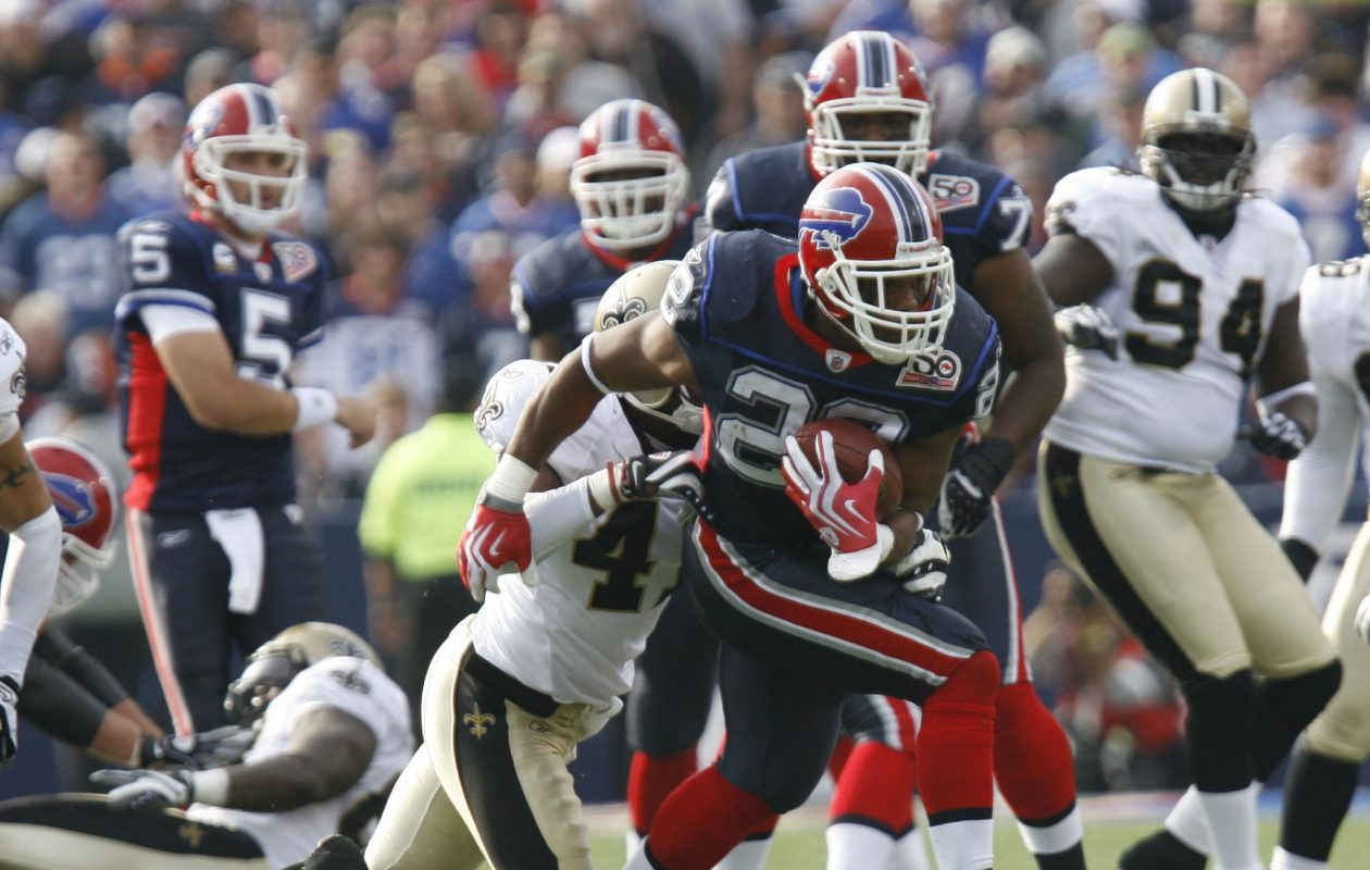 Buffalo Bills running back Fred Jackson (22) gets tackled by New Orleans Saints safety Roman Harper (41)  in first   quarter at Ralph Wilson  Stadium in Orchard Park, N.Y.  on  Sunday Sept. 27, 2009.  The Saints won, 27-7. (John Hickey/Buffalo News)