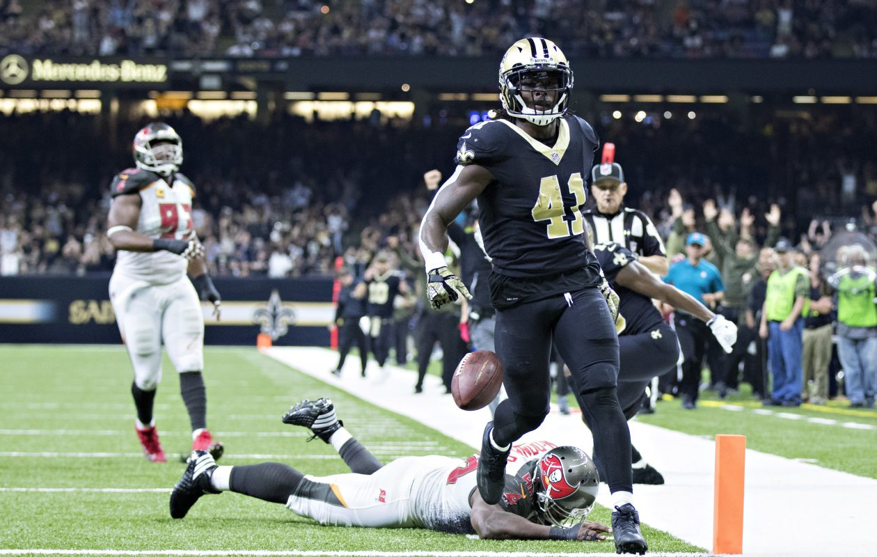 Alvin Kamara of the New Orleans Saints runs the ball in for a touchdown during a game against the Tampa Bay Buccaneers. (Getty Images)