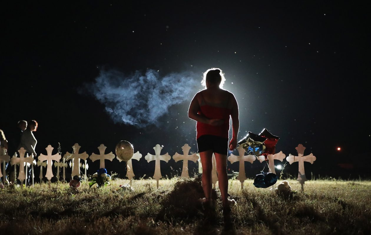 Twenty-six crosses stand in a field on the edge of town to honor the 26 victims killed at the First Baptist Church of Sutherland Springs on Nov. 6, 2017, in Sutherland Springs, Texas. A gunman, Devin Patrick Kelley, shot and killed the 26 people and wounded 20 others when he opened fire during a Sunday service. (Photo by Scott Olson/Getty Images)