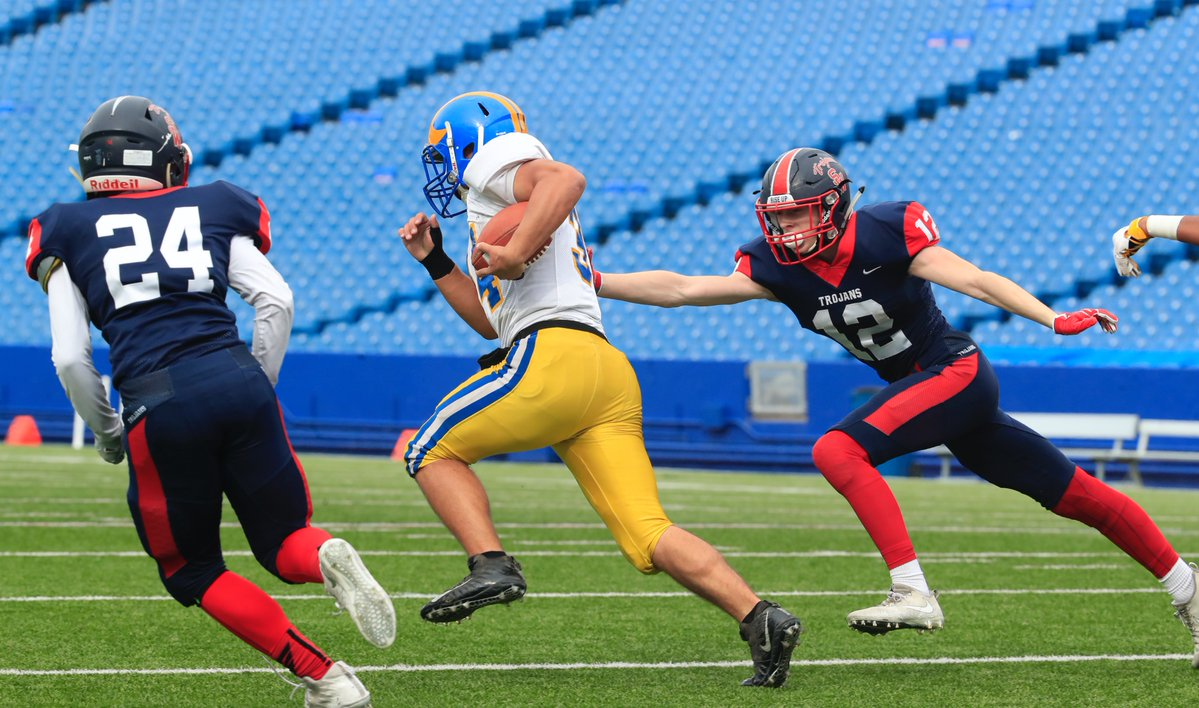 Cleveland Hill's Ryan Majerowski is off to the races on his Section VI championship-game record 99-yard touchdown run Saturday against Cleveland Hill. (Harry Scull Jr./Buffalo News)