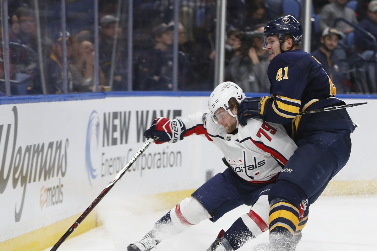 The Sabres' Justin Falk, defending Washington's Nathan Walker, earned applause Tuesday with a big block on Alex Ovechkin. (Mark Mulville/Buffalo News)