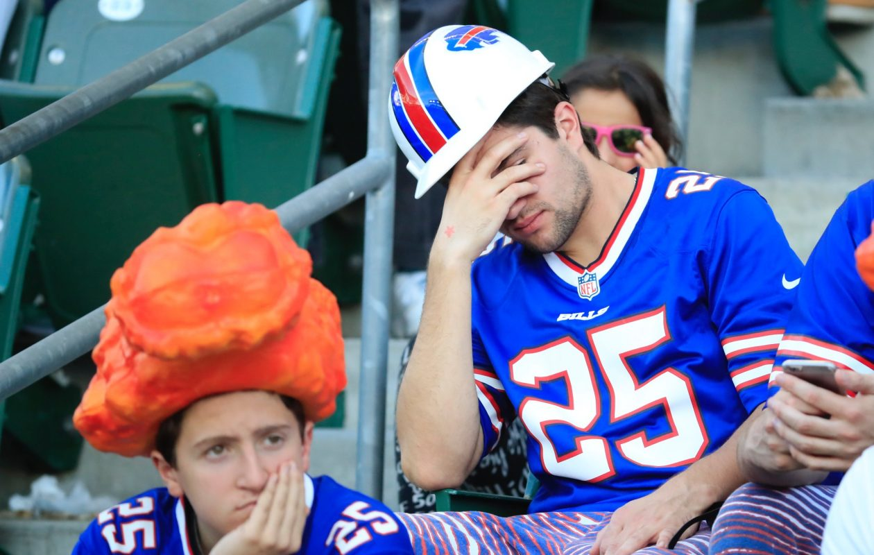 Buffalo Bills fans react after the team's 54-24 loss to the Los Angeles Chargers. (Harry Scull Jr./Buffalo News)