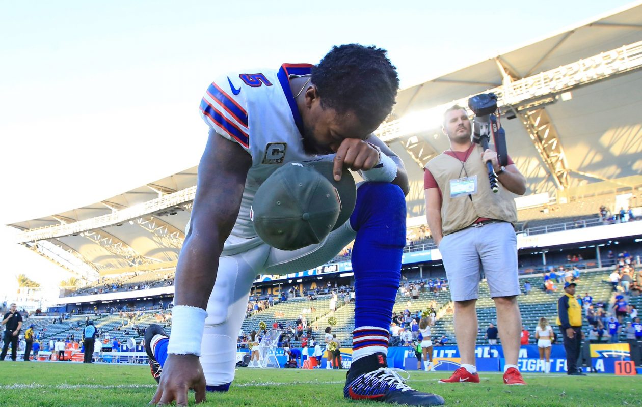 Buffalo Bills quarterback Tyrod Taylor kneels to pray at StubHub Stadium after the Bills' 54-24 loss to the Los Angeles Chargers. (Harry Scull Jr./Buffalo News)