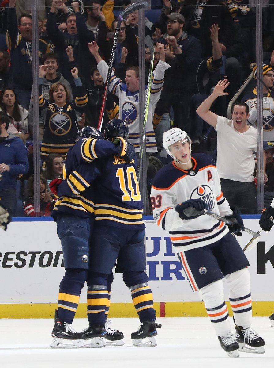 Sabres fans embrace the celebration as Jacob Josefson (10) opens the scoring during the second period Friday. (Sharon Cantillon/Buffalo News)