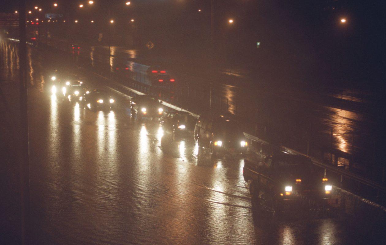 Motorists drive cautiously along a slightly flooded roadway in the Buffalo area. (Robert Kirkham/Buffalo News file photo)