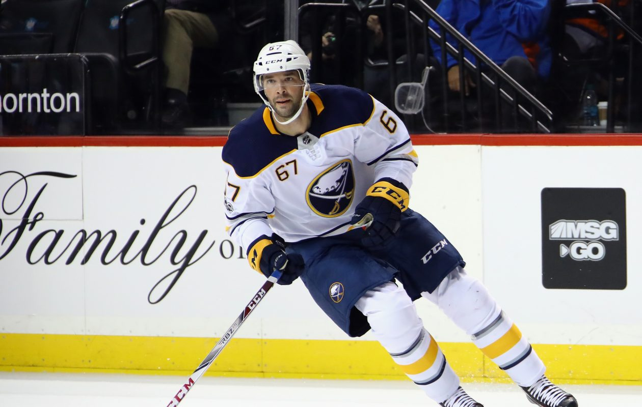 A goal by Benoit Pouliot early in the second period gave the Sabres a 2-1 lead against Arizona. (Getty Images)