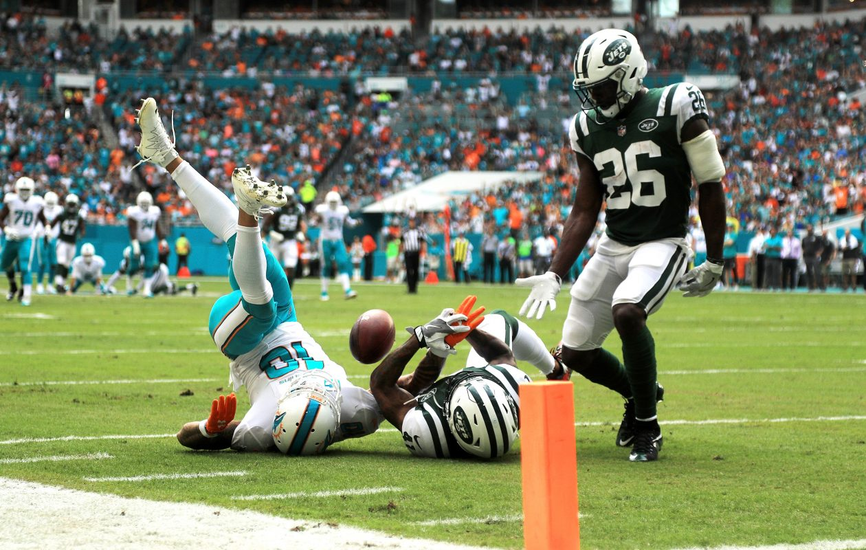 Kenny Stills of the Miami Dolphins attempts to make the catch over Buster Skrine (26) of the New York Jets.  (Getty Images)