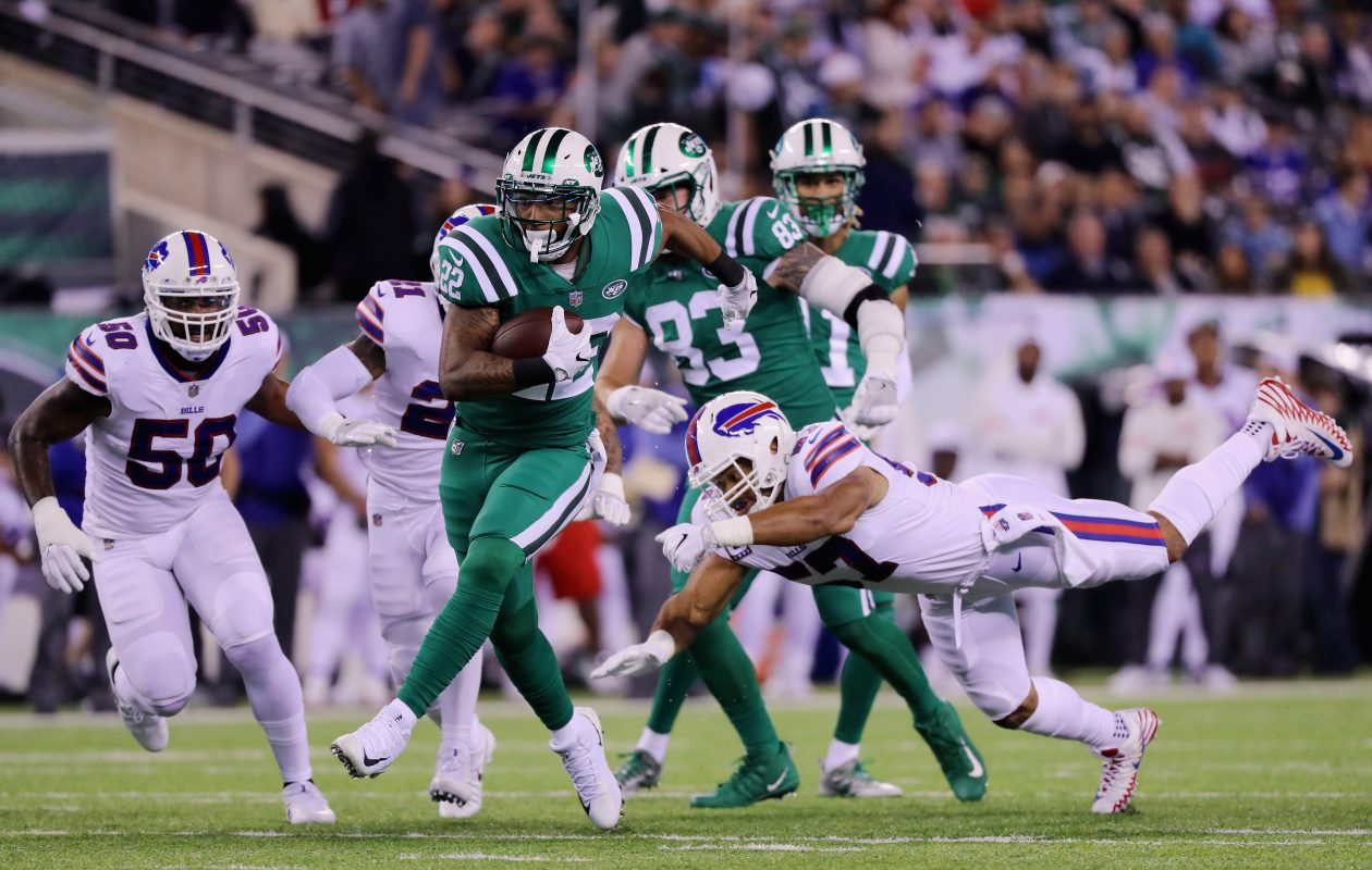Running back Matt Forte of the New York Jets runs the ball against outside linebacker Lorenzo Alexander of the Buffalo Bills during the first quarter of the game at MetLife Stadium. (Getty Images)