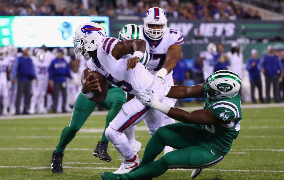 Quarterback Tyrod Taylor  is sacked by  Jordan Jenkins. (Al Bello/Getty Images)