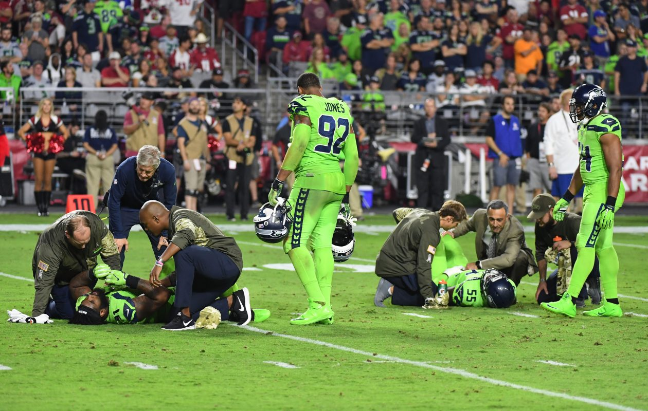 Defensive end Frank Clark and defensive tackle Sheldon Richardson of the Seattle Seahawks both lay on the field  (Photo: Norm Hall/Getty Images)
