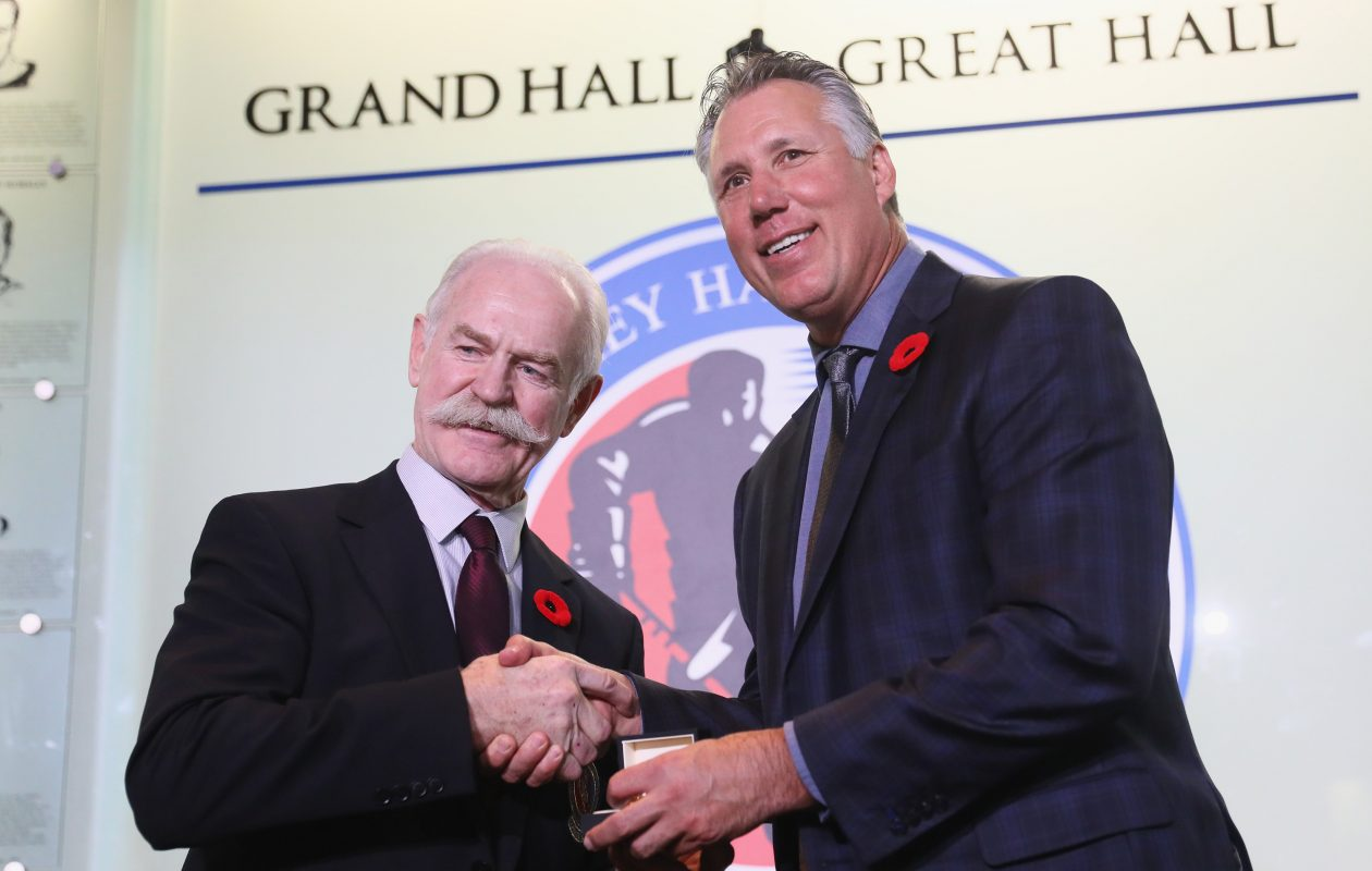 Chairman of the Hockey Hall of Fame Lanny McDonald presents Dave Andreychuk with the Hall ring at the Hockey Hall Of Fame and Museum in Toronto. (Getty Images)